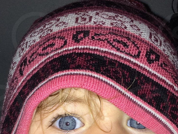 Child blue eyes hat pink white black blonde hair photo