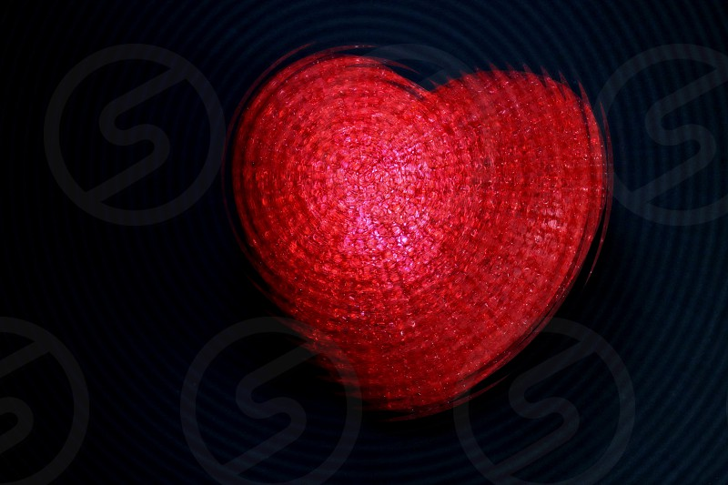 Thump - Thump a red pebbled plastic heart with a corner lighted photo
