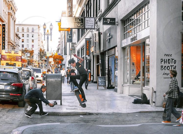 Teenage boys skateboarding on a busy city street in San Francisco  photo