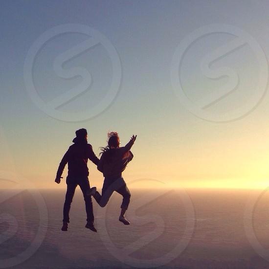 man and woman jumping photo