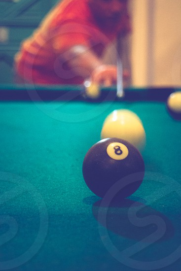 Pool table going for the number 8 black ball photo