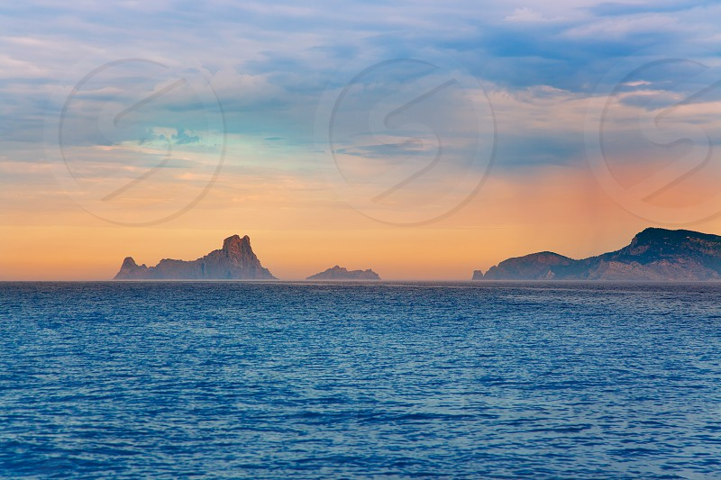 Ibiza sunset Es Vedra in Balearic islands view from Mediterranean sea photo