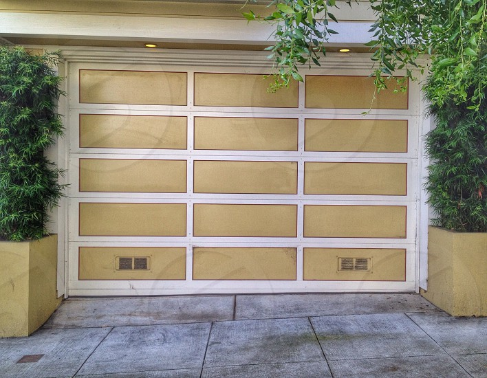 white and beige garage door photo