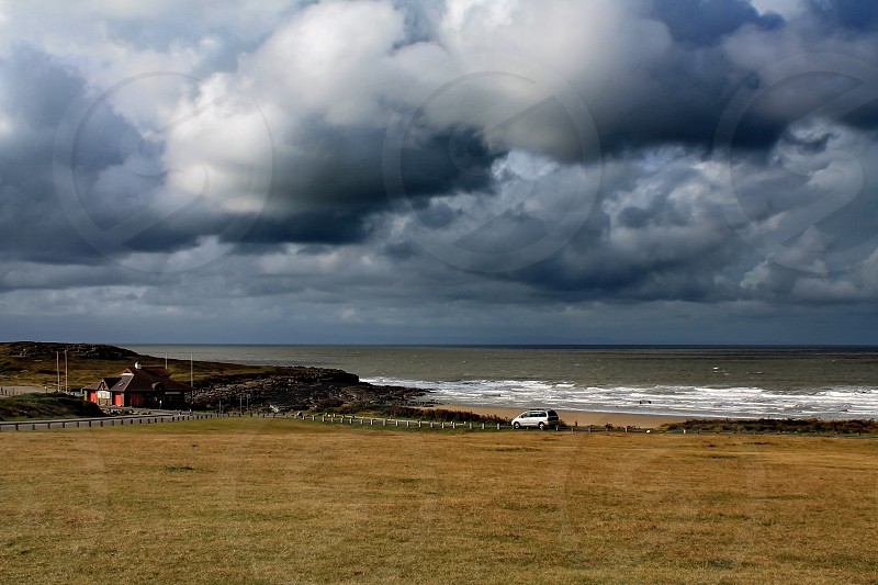Cloud gray overcast stormy weather Ocean  photo