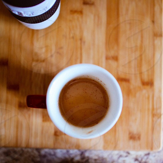 red and white coffee mug photo