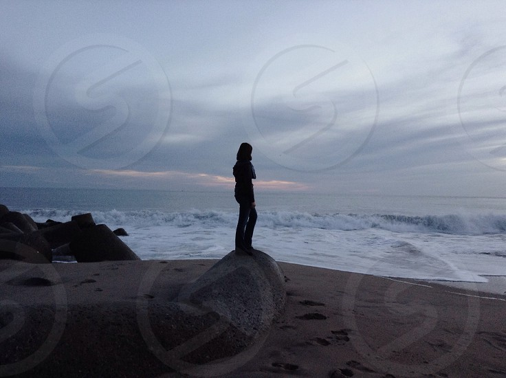 man standing in rock silhouette  photo