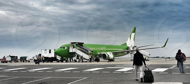 air flight boarding plain aircraft runway travel luggage photo