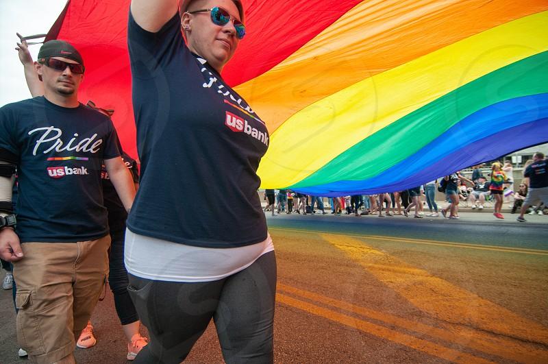 Pride parade lgbt lgbtq people family love flag colorful rainbow photo