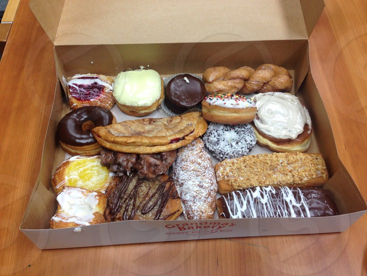 cardboard box of various pastries and donuts photo