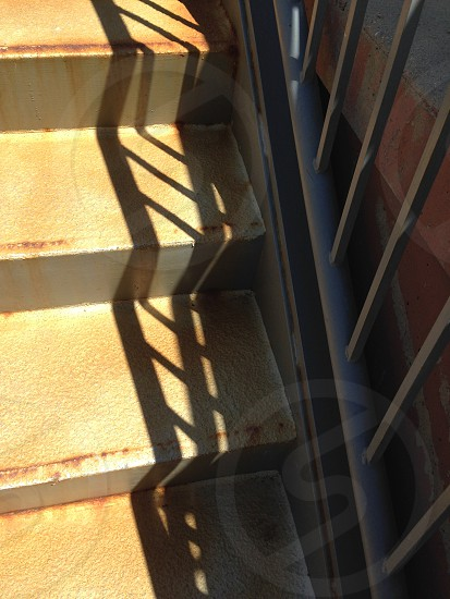 Stairs railings and shadows. photo