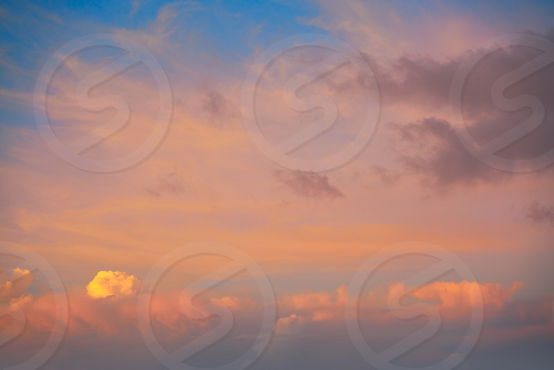 sunset sky with orange golden clouds on blue background by tono balaguer photo stock snapwire photo by tono balaguer sunset sky with orange golden clouds on blue background