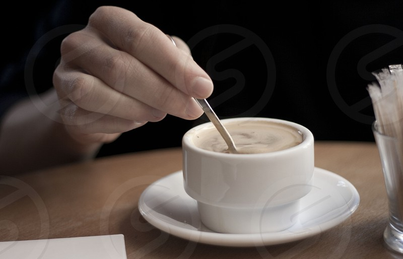 white ceramic cup & saucer photo