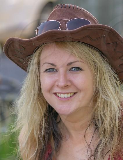 A portrait of a pretty lady in a cowboy hat. photo