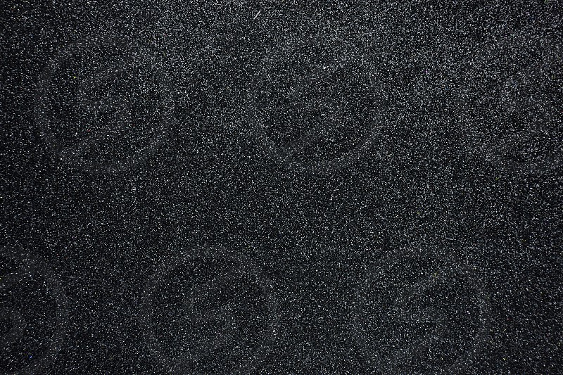 Abstract black background sandpaper with texture for presentation Close-up photo