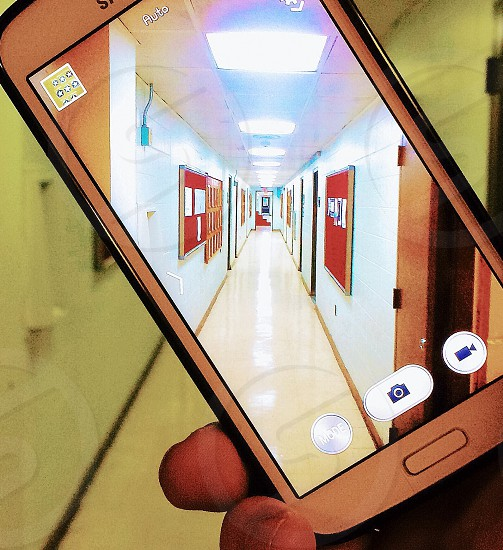 Picture of an Android phone capturing an image of a hallway. photo