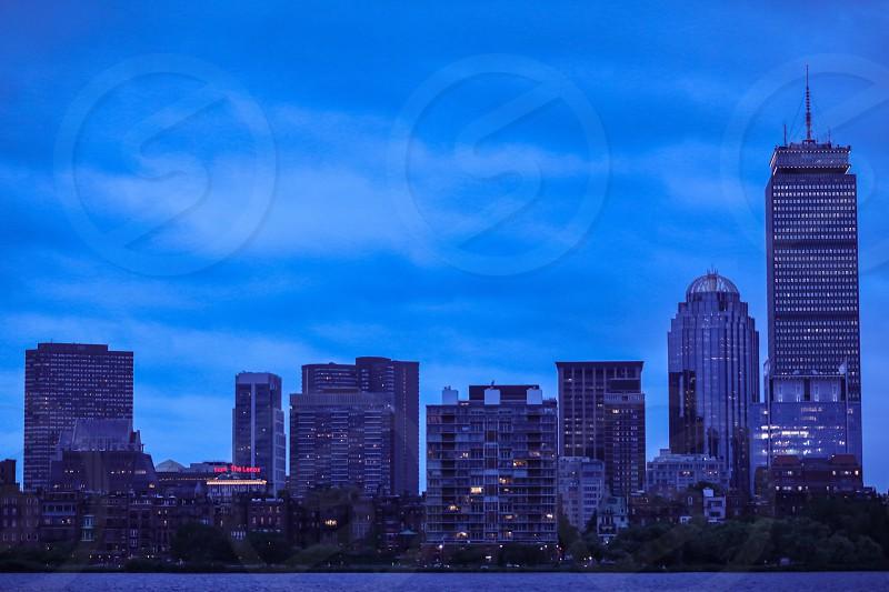 Bostonarchitecturebuildingbuildingsriverwaterskyscraperskyscrapersskylinelong expolong exposurenightcityurbanpopulationlightlightswindowssignsignsscenicsceneryduskdarkmodern photo