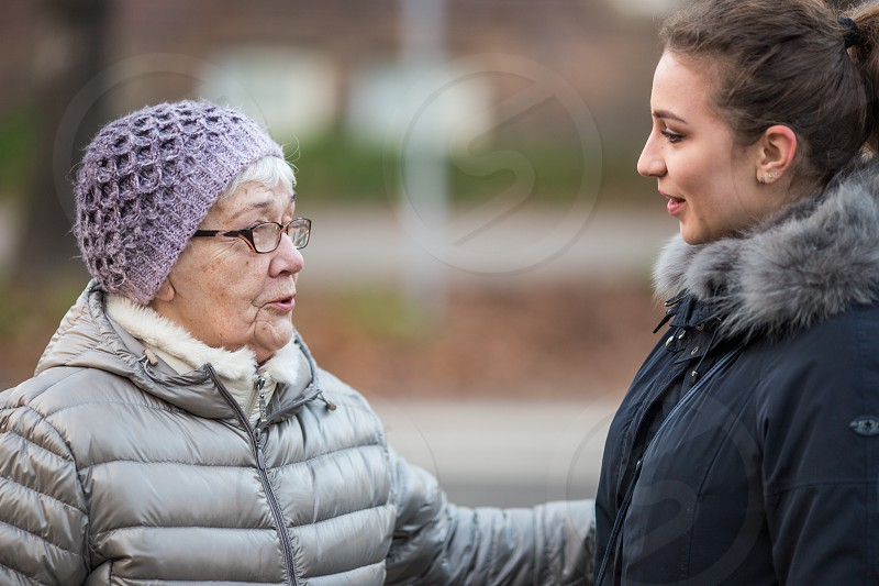 Girl talking to grandmother photo