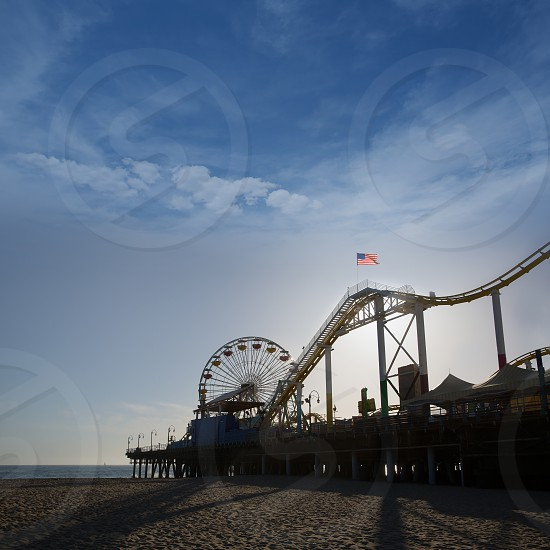 Santa Moica pier Ferris Wheel at sunset in California USA photo