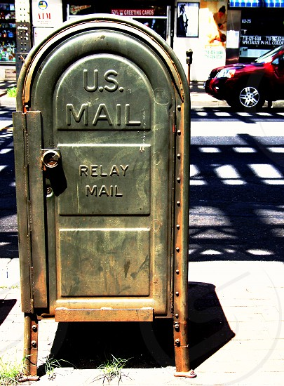 Seen in New York City a green retro metal mailbox. photo