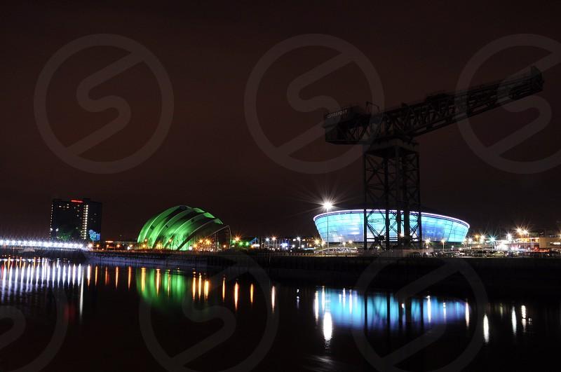 silhouette of metal crane during nighttime photo