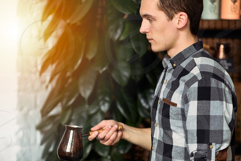 Man with coffee cup do his job on coffee place photo