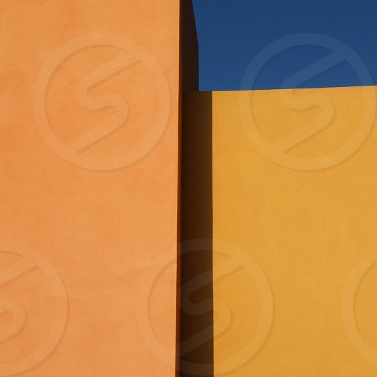 Abstract geometric detail of a facade of a yellow building photo