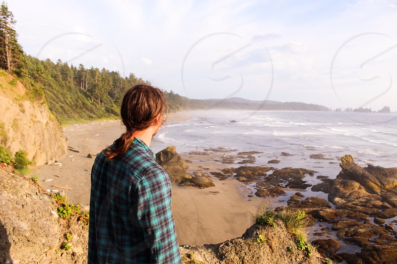 Portrait ocean view view oceans sea waves isolation beach alone lonely lonesome ponytail man person sad photo