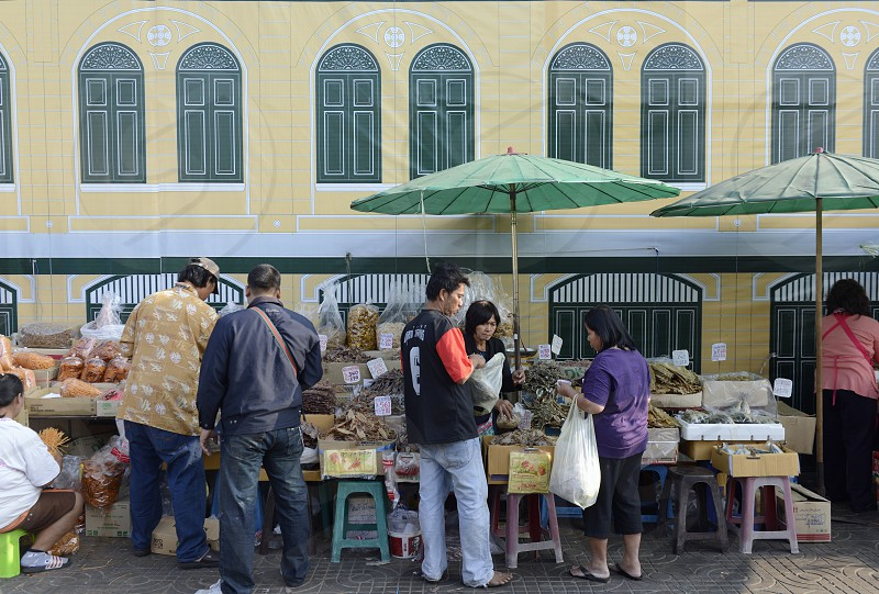 a market street near the Wat Pho at teh Mae Nam Chao Phraya River in the city of Bangkok in Thailand in Southeastasia. photo