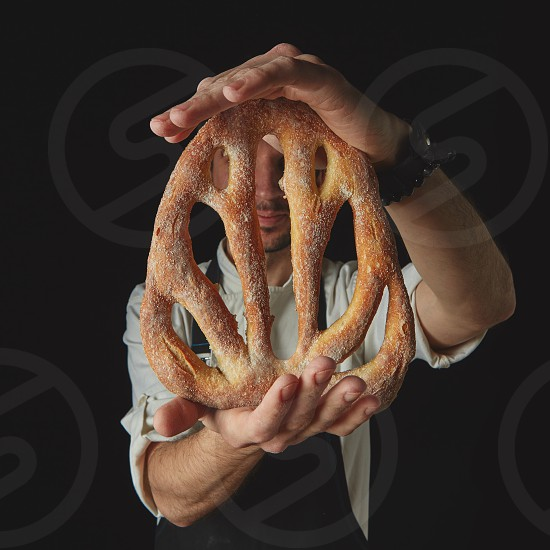 Homemade fougas bread in the hands of a baker photo