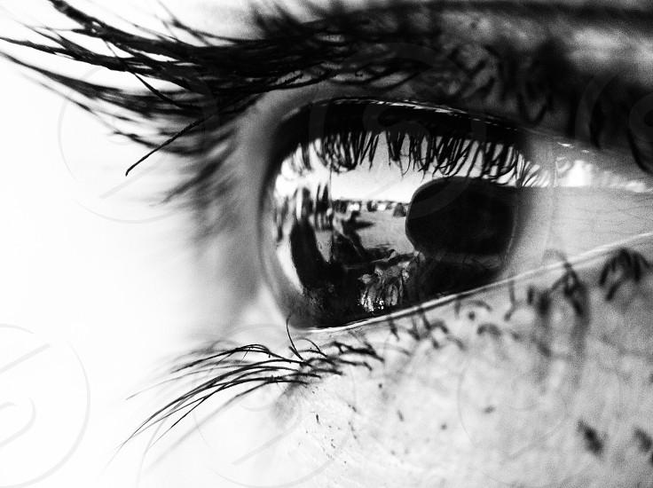 human eye grayscale photography photo