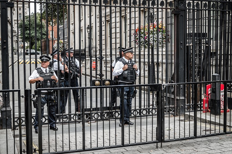 Policemen in 10 Downing Street residence of English Prime Minister in London photo