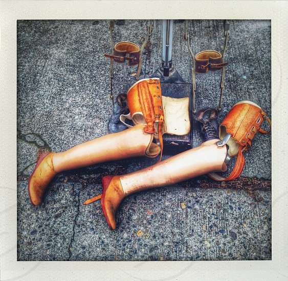 Antique prosthetic legs on the ground photo