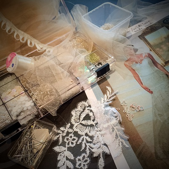 Indoor day square colour sewing embroidery lace sequins buttons beads thread needle craft tailor tailoring wedding bride dress prepare preparation delicate dainty pretty vintage home made homemade bridal marriage sew make gems stones shiny glass sparkly sparkling pearl net veil photo