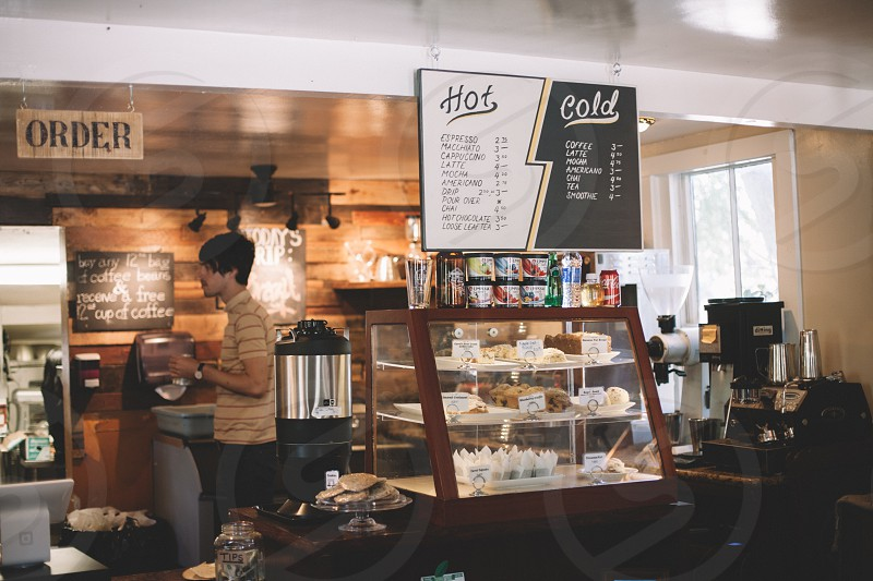 view of a coffee shop and pastries photo