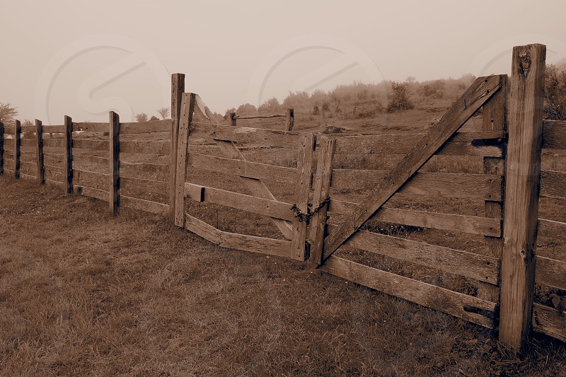 Old fence. Gate. Corral. Sepia. Wood. Ranch. photo