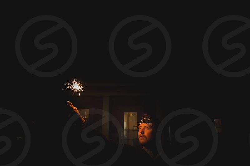 man holding fireworks photo
