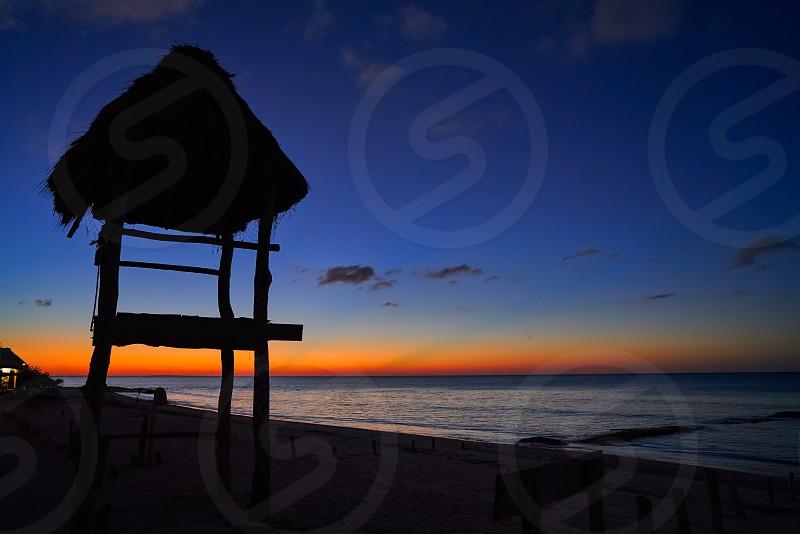 Holbox island sunset beach tropical hut in Mexico photo