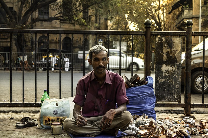 India streets seller man smoking culture city photo