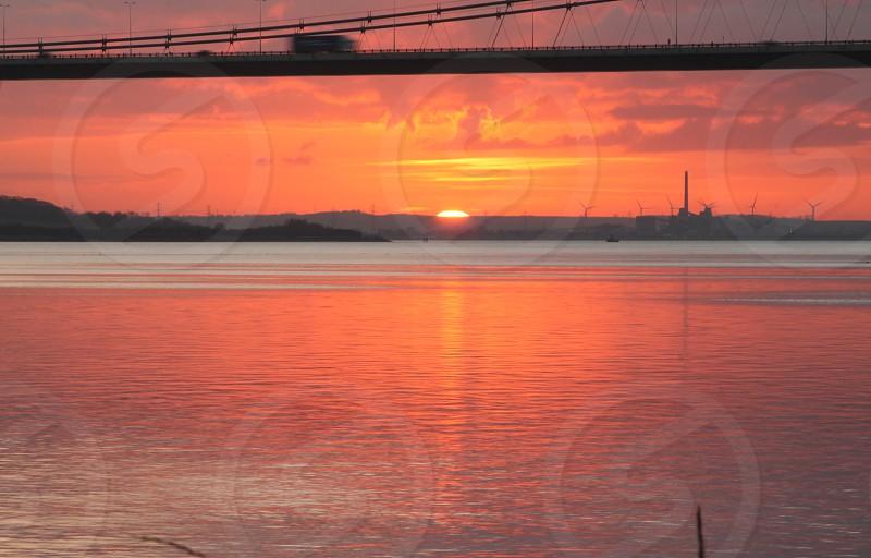 Moving cars on the Humber Bridge Hull Yorkshire at sunset photo