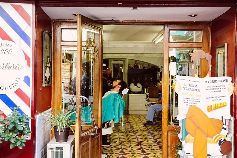 Neighborhood storefront  barbershop street view door window photo