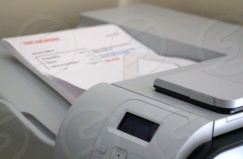 invoice account summary on gray printer photo