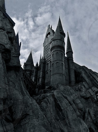 castle on top of hill gray scale low angle photography photo