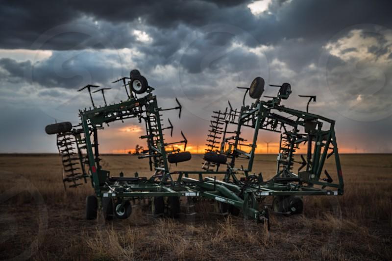 Sky storm sunset harrows farm equipmentwind farm turbines  photo