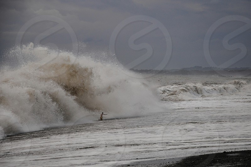 person surfing on ocean wave photo