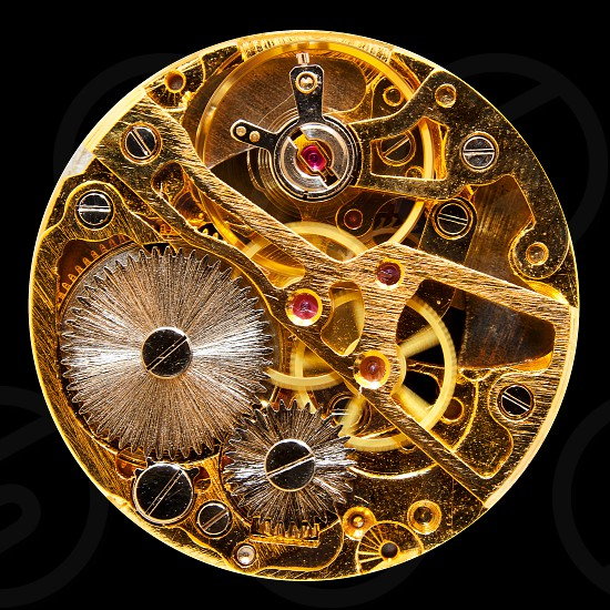 Macro shot of the interior of an old pocket watch with a hand-wound mechanical movement photo