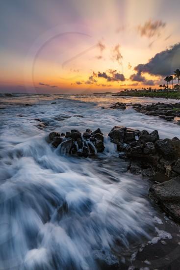 A dramatic sunset looking over the Pacific Ocean. Kauai Hawaii. photo