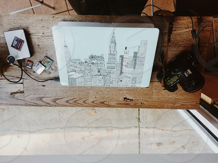 black dslr camera beside empire state building sketch photo