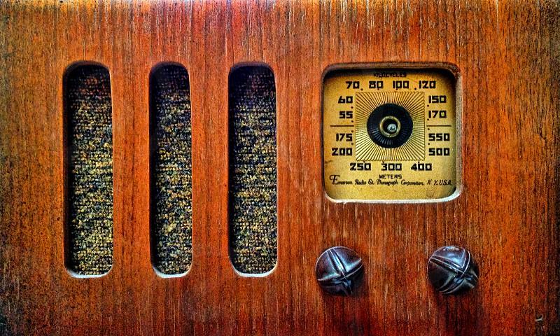 Wooden vintage radio close-up photo