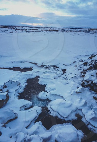 Outdoor day vertical colour panoramic snow snowy ice icy stream water Iceland Europe European winter travel photo