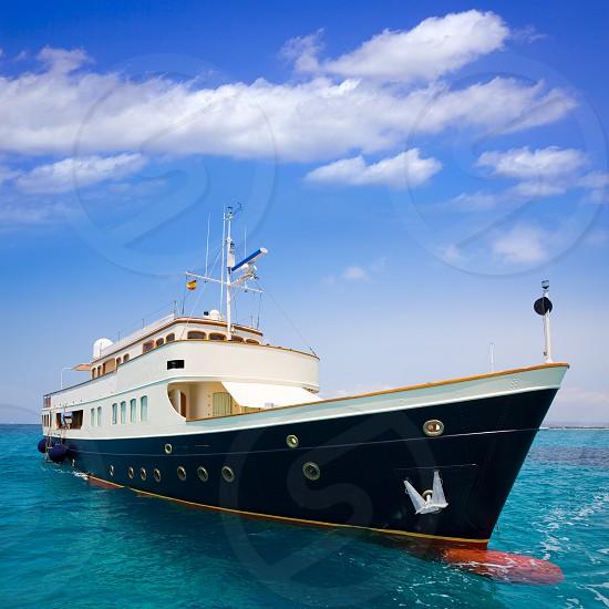 Illetes Illetas Formentera yacht anchored in turquise Balearic Mediterranean photo